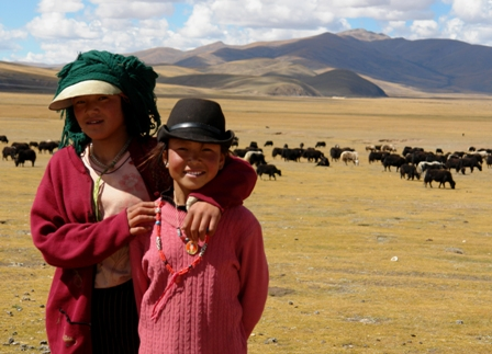 Young women herding yaks near Chamdo at 15,000 ft. elevation