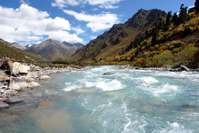 A raging glacial stream near Ranwu Lake in Eastern Tibet provides a symbol of a journey to be taken.